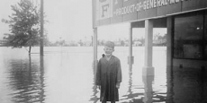 Young lad outside a Macksville electrical goods store during flood Date of photograph: probably 1954