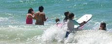 Surfing fun on Shelley Beach © 2005 Photo by Nambucca Graphics